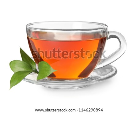 Glass cup of hot aromatic tea on white background #1146290894