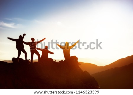 Group of happy friends having fun at sunset time on mountain top #1146323399