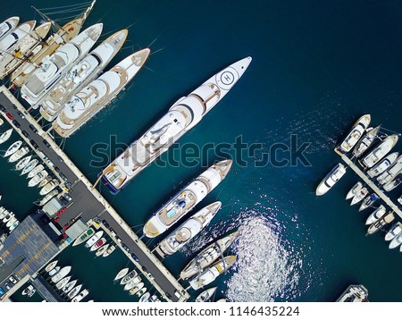 A stunning view of mega yachts in Port Hercules, Monaco.  #1146435224