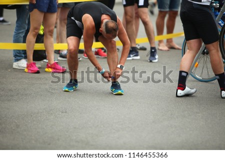 Athletes participants in the triathlon Minsk competition go through the stage of the race. Belarus, Minsk, July 22, 2018. #1146455366