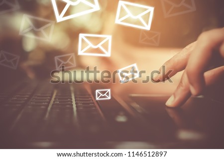 Woman hand using laptop to send and recieve email for business on bokeh vintage color tone background. #1146512897