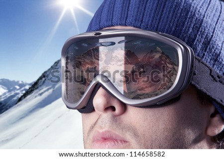 skier looking at the mountains with snowy mountains in the background. #114658582