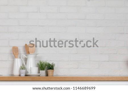 Kitchen utensils and dishware on wooden shelf. Kitchen interior background.Text space. #1146689699