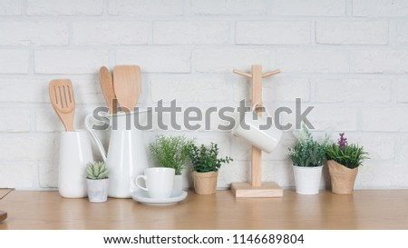 Kitchen utensils and dishware on wooden shelf. Kitchen interior background.Text space. #1146689804