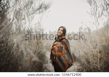 Boho woman with windy hair. Hipster girl in gypsy look, young traveler in the desert nature. #1146712400