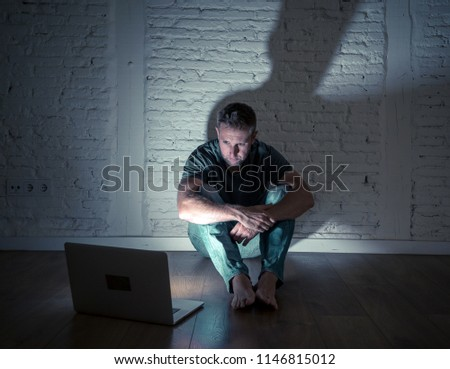 Severely distraught young men with computer laptop suffering cyberbullying and harassment being online abused by stalker or gossip feeling desperate and humiliated in cyber bullying concept. #1146815012