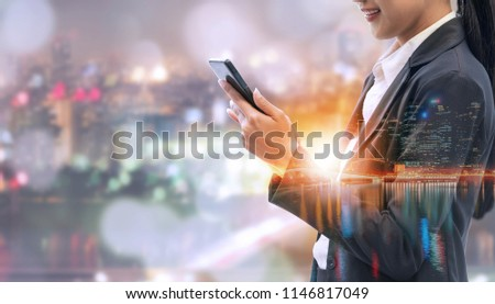 Young businesswoman using mobile phone with modern city buildings background. Future telecommunication technology and internet of things ( IOT ) concept. #1146817049