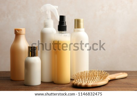 Hair care products on a wooden table on a neutral background. #1146832475