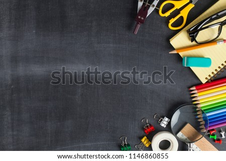 School supplies on black board background. Back to school concept #1146860855