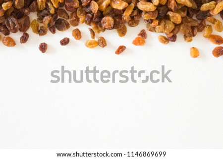 Different, colorful raisins on the white background. Dried grapes. Healthy, sweet food. Empty place for text or logo. #1146869699