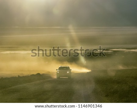 Scenic View of a Car driving on dusty Road during Sunset- Death Valley National Park, Nevada / California, USA #1146901346