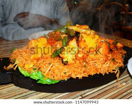Rice cooked with chicken, smoked sausage and tomatoes      #1147099943
