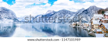 Panorama view of Hallstattersee lake and mountain in daylight with snow. Landscape view of famous Hallstatt lakeside town during winter. Town square in Hallstat. Salzkammergut region, Austria. Europe #1147101989