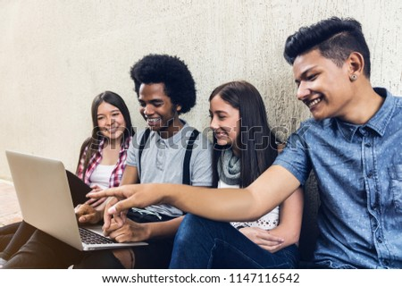 Young students team studing with a laptop #1147116542