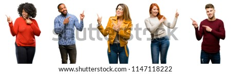 Group of cool people, woman and man pointing away side with finger #1147118222