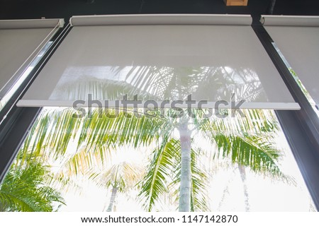 curtain or blinds Roller sun protection and big Glass windows. Royalty-Free Stock Photo #1147142870