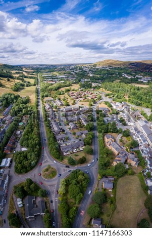 Aerial view of a UK roundabout and roads in a small welsh town called Blaina #1147166303