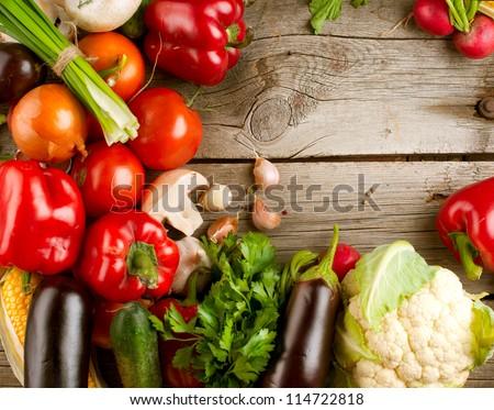 Healthy Organic Vegetables on a Wooden Background. Art Border Design #114722818