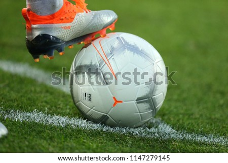 JULY 29, 2018 - KHARKIV, UKRAINE: Close-up view of Nike Merlin Quickstrike official ball. White color. Puma boots with the thorns on the ball. Ukrainian Premier League. Shakhtar Donetsk - Arsenal Kyiv #1147279145