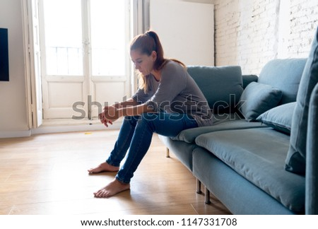 Young attractive latin woman lying at home living room couch feeling sad tired and worried suffering depression in mental health, problems and broken heart concept. #1147331708