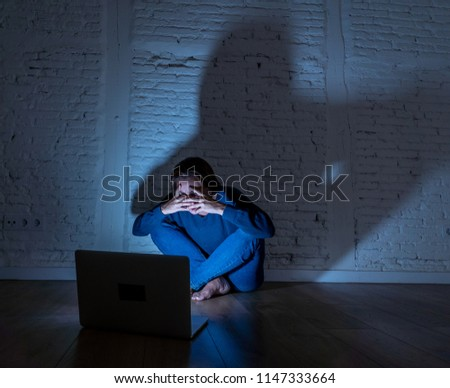 Sad and scared female Young woman with computer laptop suffering cyberbullying and harassment being online abused by stalker or gossip feeling desperate and humiliated in cyber bullying concept. #1147333664