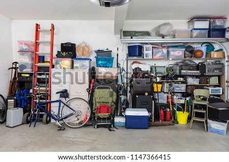 Garage storage shelves with vintage objects and equipment. #1147366415