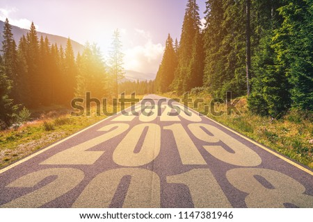 Empty asphalt road and New year 2018, 2019, 2020 concept. Driving on an empty road in the mountains to upcoming 2018, 2019, 2020 and leaving behind old years. Concept for success and passing time. #1147381946