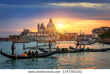 Grand Canal with gondolas in Venice, Italy. Sunset view of Venice Grand Canal. Architecture and landmarks of Venice. Venice postcard #1147382102