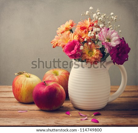 Beautiful flower bouquet and fresh apples on wooden tabletop #114749800