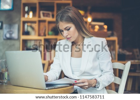 Young business woman working on laptop. #1147583711