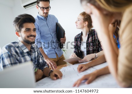 Image of business partners discussing documents and ideas #1147604972