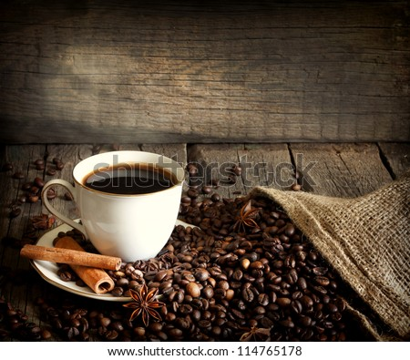 Cup of coffee with beans and cinnamon vintage still life #114765178