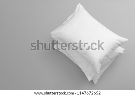 Clean soft bed pillows on grey background, top view #1147672652
