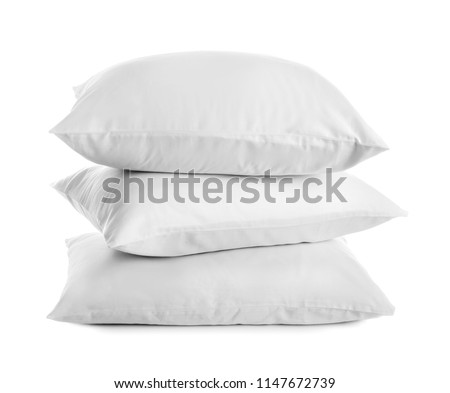 Clean soft bed pillows on white background #1147672739