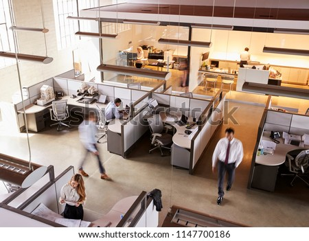Elevated view of staff working in a busy open plan office Royalty-Free Stock Photo #1147700186