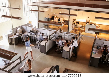 Elevated view of a busy open plan office Royalty-Free Stock Photo #1147700213