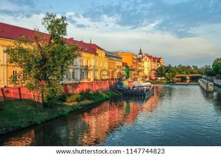 Landscape, old buildings under the river, Poland, sunset #1147744823