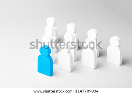 Concept leader of the business team indicates the direction of the movement towards the goal. Crowd of white men goes for the leader of the blue color #1147789034