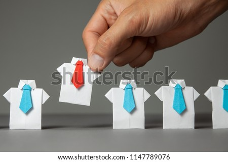 Choosing good employee leader. Man chooses and takes in the hand an employee in shirt and red tie. Staff recruitment. Royalty-Free Stock Photo #1147789076