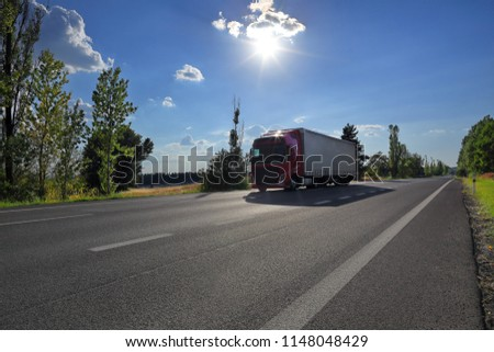 Truck transportation on the road at sunset #1148048429