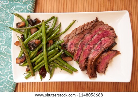 seared flank steak with green beans and mushrooms, a ketogenic diet meal #1148056688