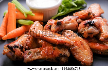 baked chicken wings with vegetable sticks, a ketogenic diet meal #1148056718
