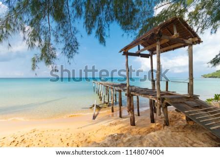 broken pier at sunset beach, turquoise water, Koh Rong Samloem, Sihanoukville, Cambodia #1148074004