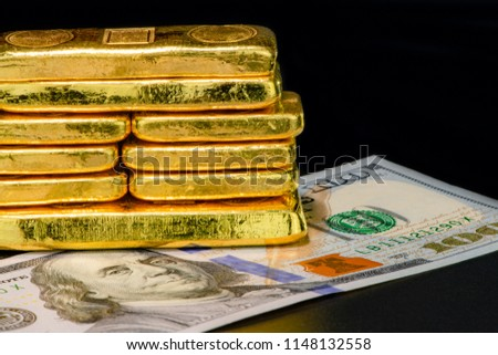 Close-up of a international currencies america US dolla banknote and gold bullion safe haven of investment and wealth concept. #1148132558
