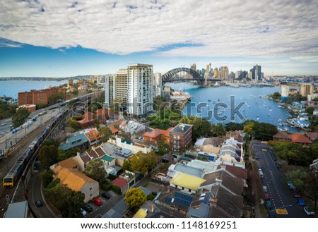 Train in Sydney city with Sydney harbor and blue sky, New South Wales, Australia Royalty-Free Stock Photo #1148169251