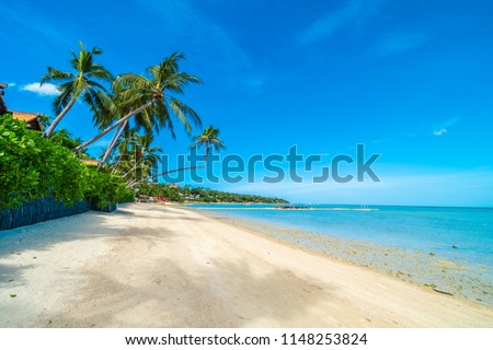 Beautiful tropical beach sea and sand with coconut palm tree on blue sky and white cloud for travel and vacation #1148253824