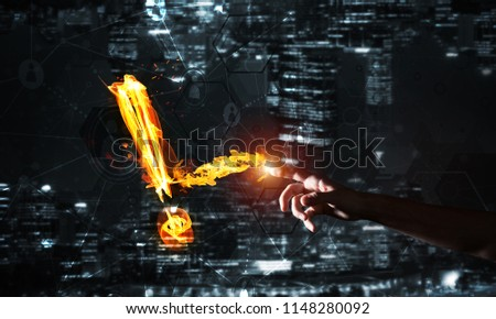 Fire exclamation mark on night city background #1148280092