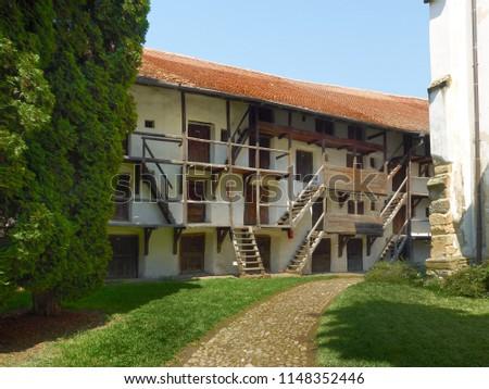Prejmer, Brasov / Romania - August 06 2014: Hive dwellings, fortified church in Prejmer, Romania #1148352446