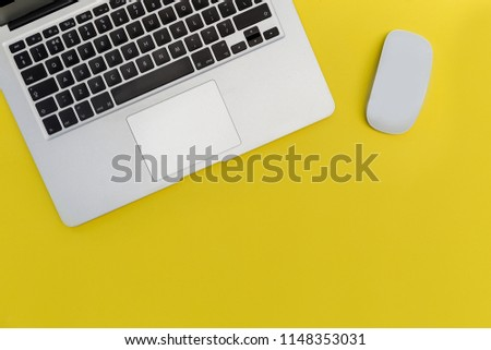 Laptop computer mouse on bright yellow background #1148353031