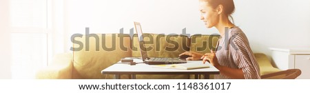 Young beautiful woman working at her home office Communication computer internet laptop Businesswoman entrepreneur organized home-based job distant location Long banner